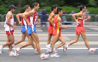 Racewalking - Men's 20-km walk during the 2005 World Championships in Athletics in Helsinki, Finland. The walker at the right appears to be illegal in that both feet are off the ground, but according to the current rules, an infraction is only committed when the loss of contact is visible to the human eye.