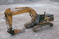 2008-08-17 CAT 345B with hammer attachment (edited).jpg