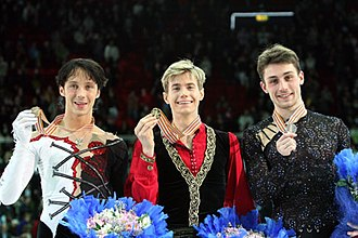 2008 World Figure Skating Championships - The men's podium. From left: Johnny Weir (3rd), Jeffrey Buttle (1st), Brian Joubert (2nd).