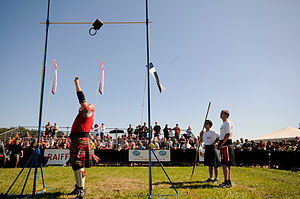 Weight throw - A man throwing a weight over a bar at the 2009 Highland Games
