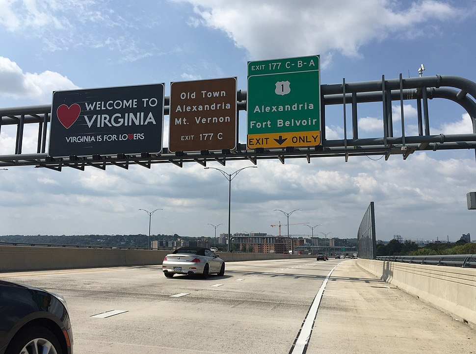 2016-09-07 12 53 27 %22Welcome to Virginia%22 sign along southbound Interstate 95 and the westbound inner loop of the Capital Beltway (Interstate 495) as it crosses the Potomac River on the Woodrow Wilson Bridge in Alexandria, Virginia