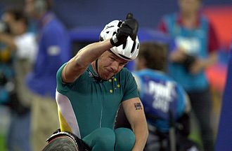 "Australia at the Paralympics - In Paralympic sport, Australia has been most successful in Athletics. Greg Smith gives the crowd a ""thumbs up"" after winning gold at the 800 m T52 final at the 2000 Summer Paralympic Games, in Sydney on Day 04."