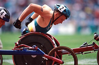 Kurt Fearnley - Action shot of Fearnley during a wheelchair race at the 2000 Sydney Paralympics