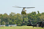 A CH-47 Chinook helicopter drops a simulated sling load 140726-A-PU919-008.jpg