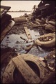 A STORM SEWER DRAINAGE LINE LEADS INTO THE MIDDLE BRANCH OF BALTIMORE HARBOR. THE OLD TIRES AND TRASH ARE FROM A... - NARA - 546913.tif