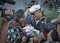 A U.S. Navy Sailor meets his child for the first time. (40097660471).jpg