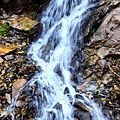 A Waterfall in the Mountains.jpg