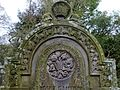 A gravestone with a flower garland and crown, St Columba's, Stewarton, East Ayrshire, Scotland.jpg