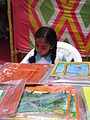 A little girl reading our books - Flickr - Pratham Books.jpg