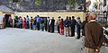 A long queue of voters to cast their votes for the Delhi Assembly Election, in New Delhi on February 07, 2015.jpg