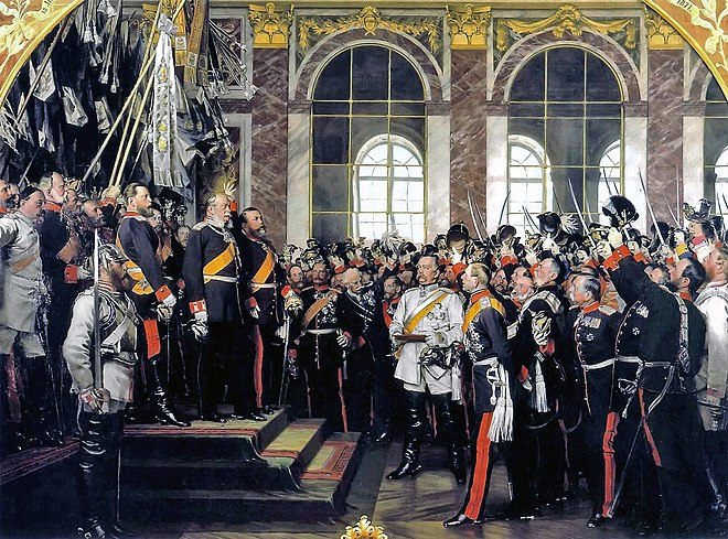 18 January 1871: The proclamation of the German Empire in the Hall of Mirrors at the Palace of Versailles. Bismarck appears in white. The Grand Duke of Baden stands beside Wilhelm, leading the cheers. Crown Prince Friedrich, later Friedrich III, stands on his father's right. Painting by Anton von Werner