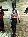 Achang woman brocade dress - Yunnan Nationalities Museum - DSC04291.JPG