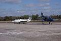 Aero Vodochody L-39C Albatros Blue7 Taxi In 09 past Aero Vodochody L-29 Delfin TICO 13March2010 (14597450594).jpg