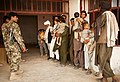 Afghans wait in line for medical treatment (5224927248).jpg