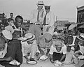 """African American males and the white """"judges"""" detail, Rice Eating Contest in Crowley, 1938 (cropped).jpg"""
