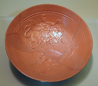 Slip (ceramics) - African red slip ware: moulded Mithras slaying the bull, from Lavinium near Rome, 400 ± 50