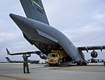 Airman 1st Class Patrick Russ directs the driver of a truck out of a C-17 Globemaster III aircraft at Joint Base McGuire-Dix-Lakehurst, N.J., on Nov 121105-F-KG812-903.jpg
