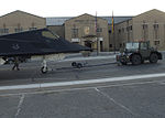 Airmen from the 49th Maintenance Squadron escort an F-117A to its new home.jpg