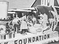 Alberta Dairy Princess, Margaret Reed, on a float in a parade (27452203060).jpg