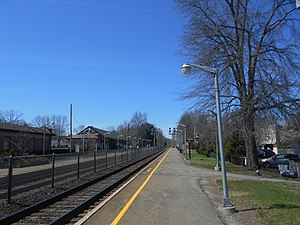 Allendale station (NJ Transit) - The outbound platform at Allendale station in 2014. The station depot is located on the left