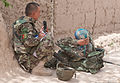 An Afghan National Army (ANA) soldier uses a radio to check on the statuses of other ANA squads and keep them on their objectives while on patrol in Panjwai district, Kandahar province, Afghanistan, April 1 120401-A-VQ566-929.jpg