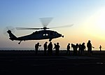 An MH-60S Sea Hawk helicopter prepares to land aboard USS Nimitz in the Arabian Gulf. (35646531964).jpg
