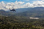 An MH-60S Seahawk approaches the village of Jabouin to deliver food. (30426926275).jpg