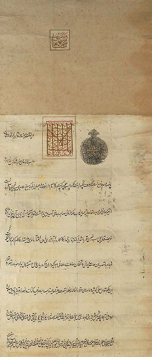 "Tughra - A Firman issued by the Mughal Emperor Shah Alam II; containing the official Mughal ""Tughra"" in black ink alongside the calligraphic signature of Shah Alam II in red."