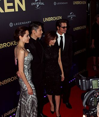 Miyavi - Miyavi with his wife Melody, Angelina Jolie and Brad Pitt at the premiere of Unbroken