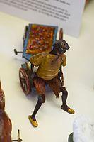 Antique wind-up tin toy black apple seller (25756235572).jpg