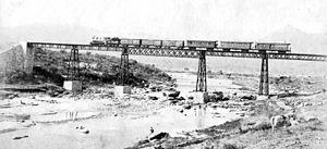 Córdoba North Western Railway - Train crossing a bridge over Cosquín river, c. 1890.