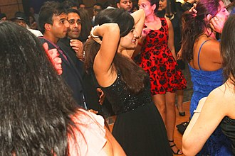 British Asian - Asian Professionals at a Summer Ball in London dancing to Bhangra