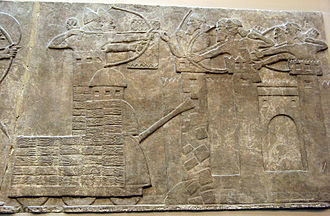 Siege tower - Assyrian attack on a town with archers and a wheeled battering ram; Assyrian Relief, North-West Palace of Nimrud (room B, panel 18) ; 865–860 BC.