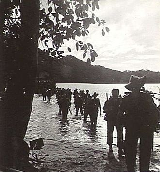 First Australian Army - Australian troops land at Open Bay, New Britain, May 1945
