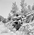 Autowrak van een pantservoertuig op een helling langs de kant van de weg, Bestanddeelnr 255-2223.jpg