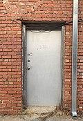 Back street back door with drain pipe, Edmond, Oklahoma, USA.jpg