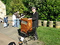 Barrel organ player, Beamish Home Farm tram stop, 6 October 2012.jpg