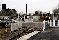 Barriers rising at Station Road level crossing, Ammanford - geograph.org.uk - 4483687.jpg