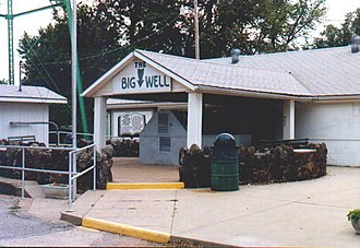 Big Well (Kansas) - Big Well visitor center. Well entrance is the gray structure at the left of the photo. Guests could view the well for free from a glass and steel structure under the portico. Visitor center destroyed by tornado on 4 May 2007.