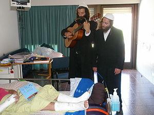Bikur cholim - Breslov Hasidim visiting the sick in hospital.