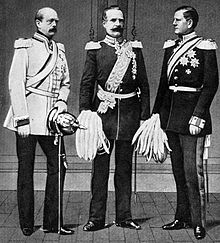 three men in military uniforms carrying pickel helmets--the ones with pikes sticking out of the crowns