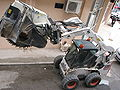 Bobcat-S300-with-wheel-saw-attachment-0a.jpg