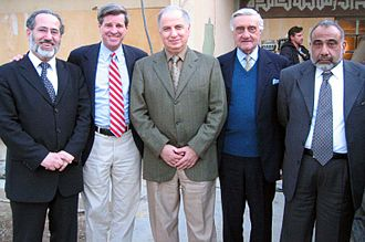 Coalition Provisional Authority - L. Paul Bremer (second from left) and four members of the Iraqi Governing Council; Mowaffak al-Rubaie, Ahmed Chalabi, Adnan Pachachi, and Adil Abdul-Mahdi. (Left to Right)