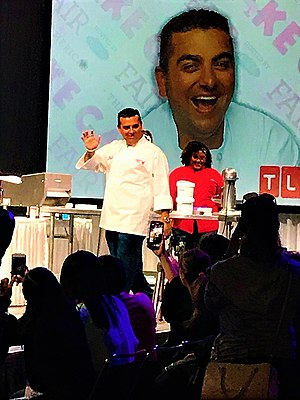 Buddy Valastro - Buddy Valastro walking out onstage waving to fans at a Cake Fair in Orlando, FL. 2017