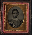 Bust portrait, young boy with boutin- niere. Cased tintype, gem tintype case, sixteenth plate.jpg