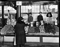Buying lettuce at the Pike Place Market, January 1924 (MOHAI 5525).jpg