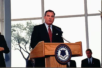 John G. Rowland is seen giving a speech.