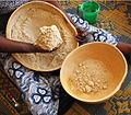 Calabash bowls - 2 hand processing millet flour,set aside dry flour.jpg