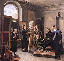 Carl Christian Vogel von Vogelstein – Pierre Jean David d'Angers modelliert die Büste Tiecks (1834). Dorothea Tieck ist rechts mit einem Buch in der Hand hinter ihrem Vater zu sehen (Quelle: Wikimedia)