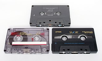Compact Cassette - Cassettes of varying tape quality and playing time. The top is a Maxell MX (Type IV), bottom right is a TDK SA (Type II) and the bottom left is a TDK D (Type I).